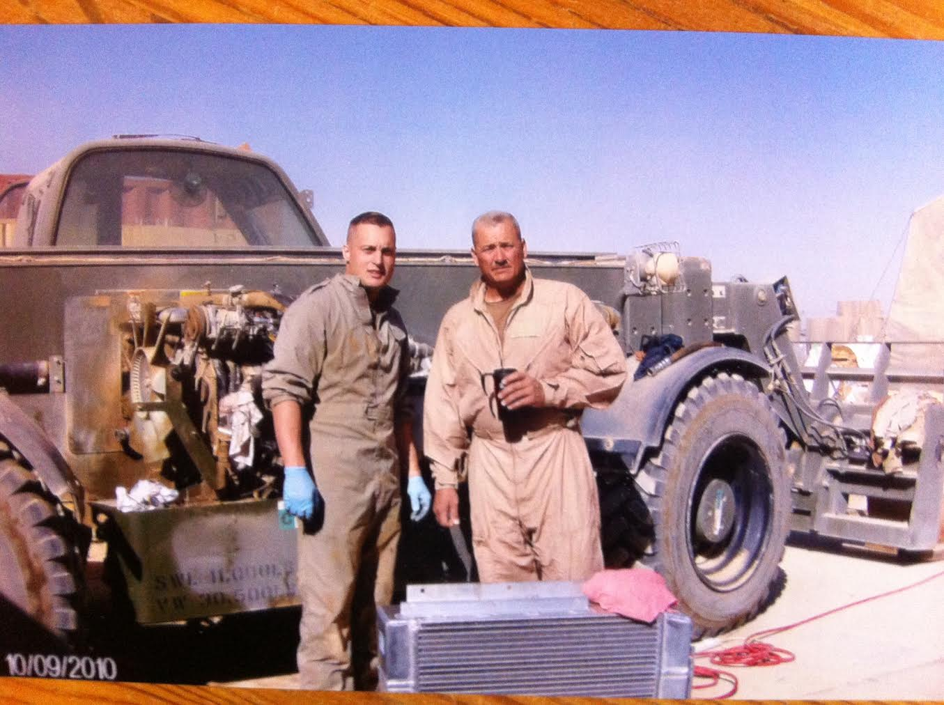 Seabees...Construction Mechanic 2nd Class Jason Quick and Steelworker 1st Class Uncle Sam Montgomery(notice his coffee cup)