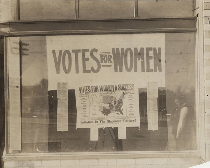 Womens_suffrage_propaganda_in_the_window_of_a_vacant_store_in_Birmingham_Alabama