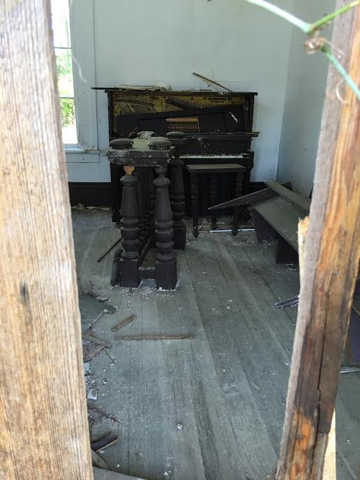 Antique piano inside the remains of Good Hope Baptist (Amanda Gallatin)