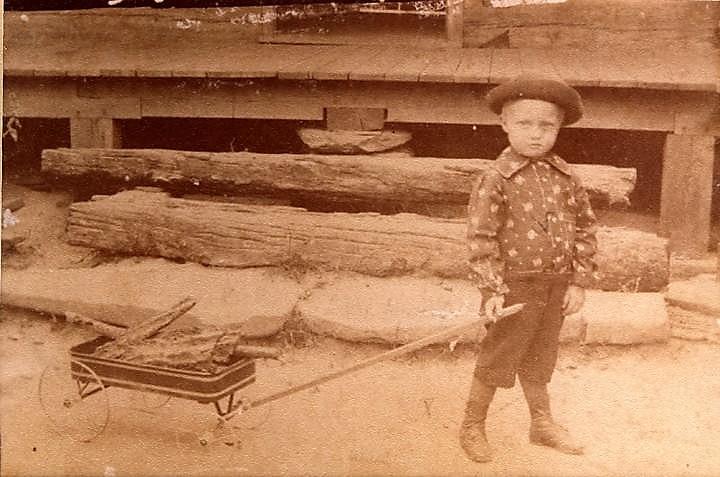Benjamin_Hugh_Tucker_pulling_wagon_of_sticks