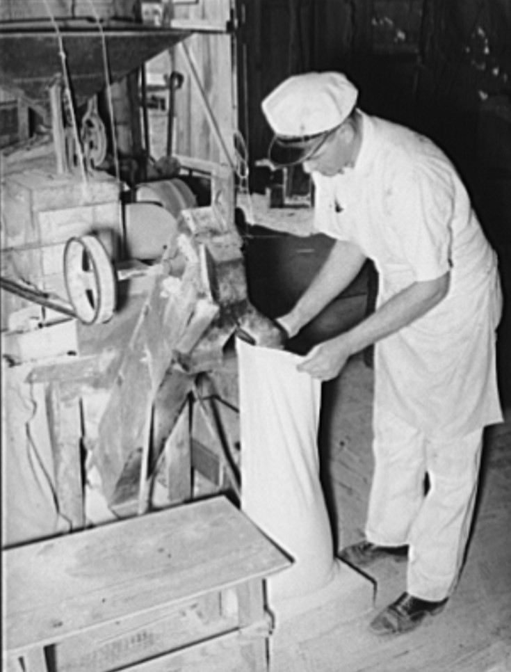 Proprietor filling sack with freshly ground corn meal 1939 (Library of Congress) (2)