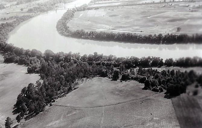 Site of ancient an Coosa village at the edge of a river in Alabama. Note on back - field to right site of ancient Coosa village (ADAH)