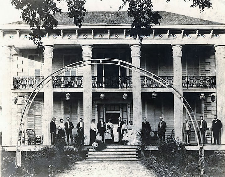 Thompson, Joseph Oswalt, 1869 Macon -Family gathered on the front porch of the house on the Thompson homestead in Tuskegee, Alabama (ADAH)