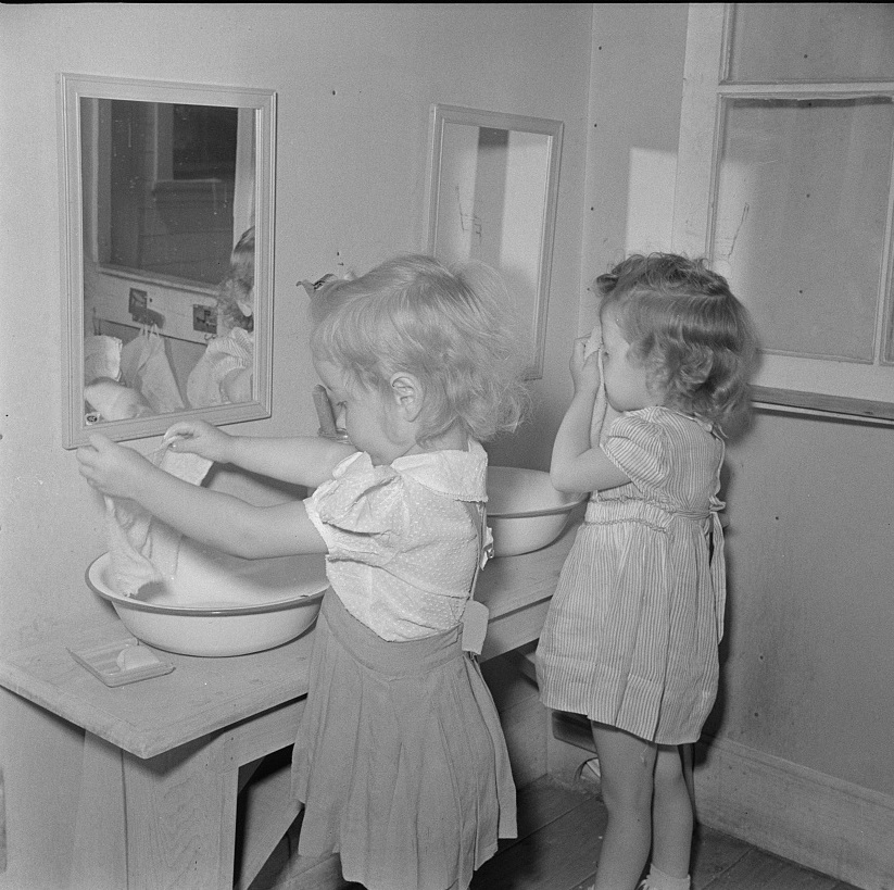 Childersburg, Alabama. Children washing in WPA day nursey for defense workers' children May 1942 (John Collier, LOC)