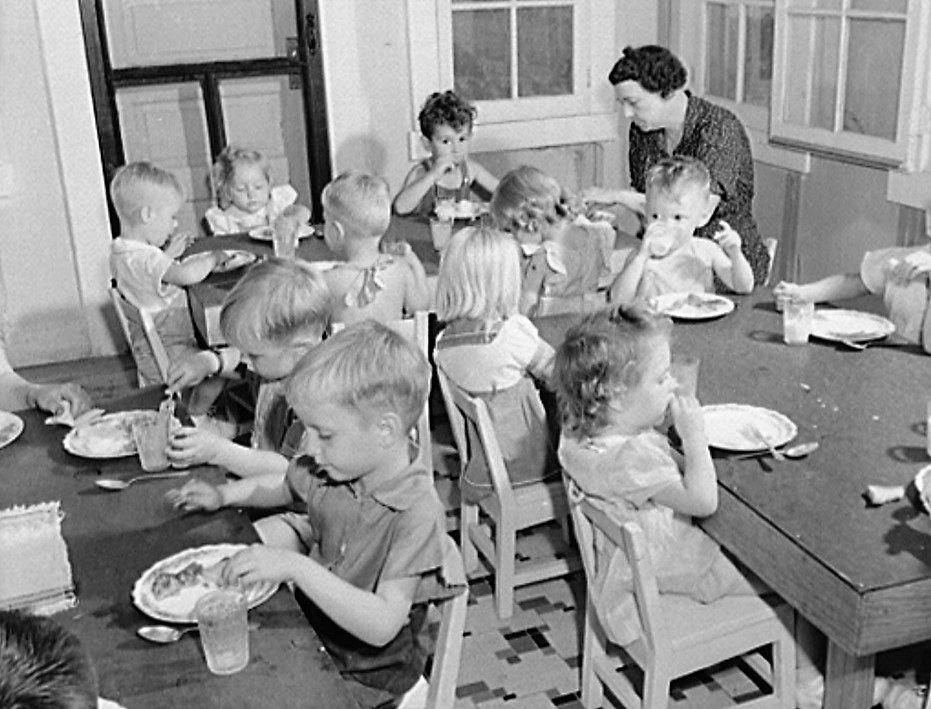 Childersburg, Alabama. Lunch period in the WPA day nursey for defense workers' children, May 1942 (John Collier, LOC)