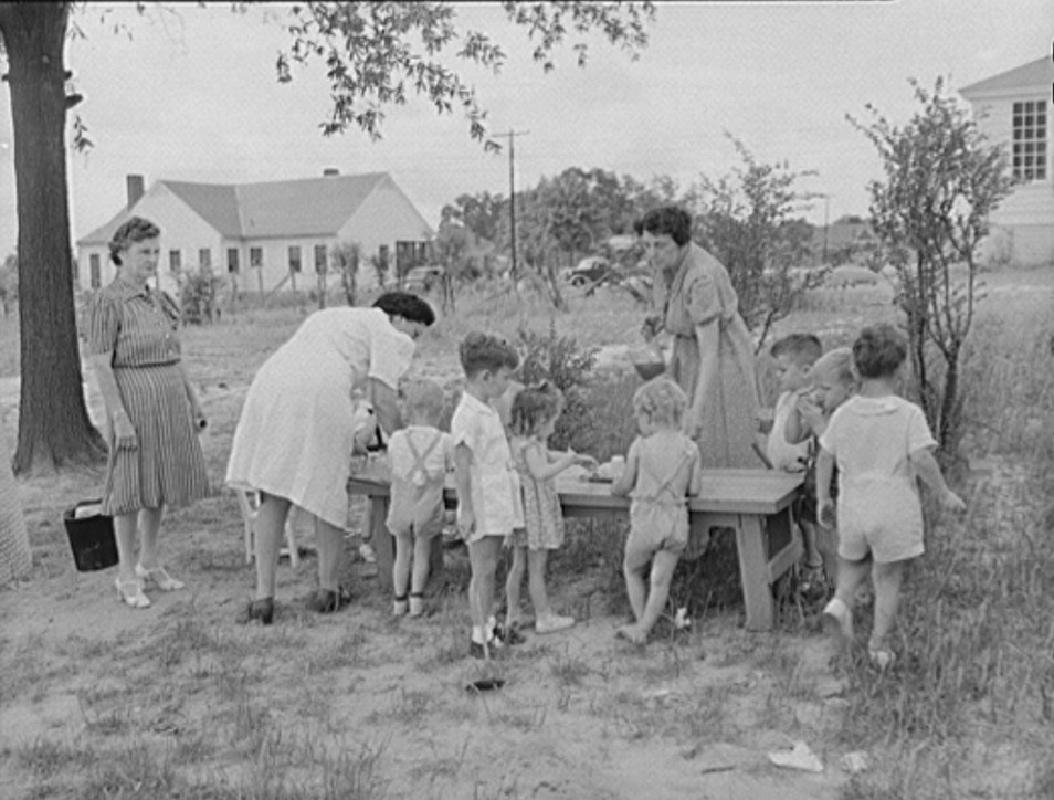 Childersburg, Alabama. Tomato juice is served to the children at 10 a.m. in the WPA day nursey for defense workers children May 1942 John Collier