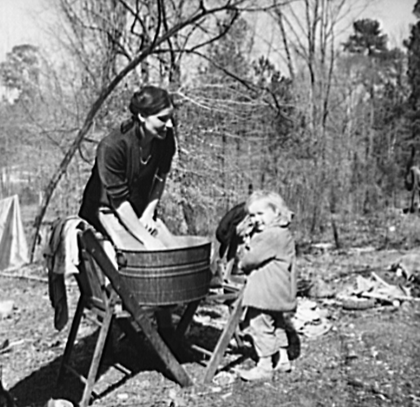 Washing clothes in a migrant camp near Birmingham, Alabama (Library of Congress)