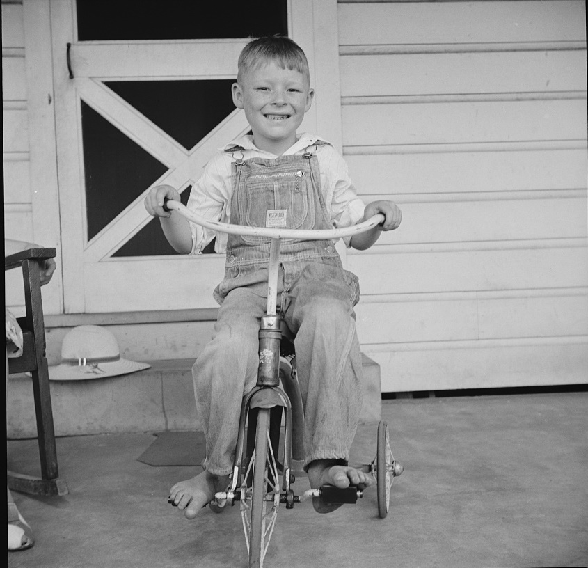 Youngest of the Clark children says he wants to be a truck driver when he grows up. Coffee County, Alabama (1941 by John Collier, Library of Congress)
