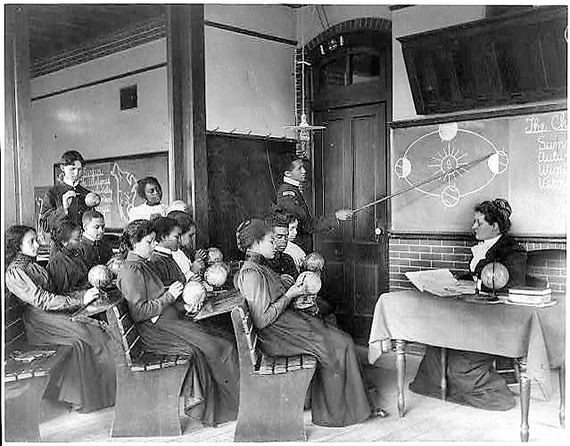 A class in mathematical geography studying earth's rotation around the sun, Hampton Institute, Hampton, Virginia, (Frances Benjamin Johnston, Library of Congress)