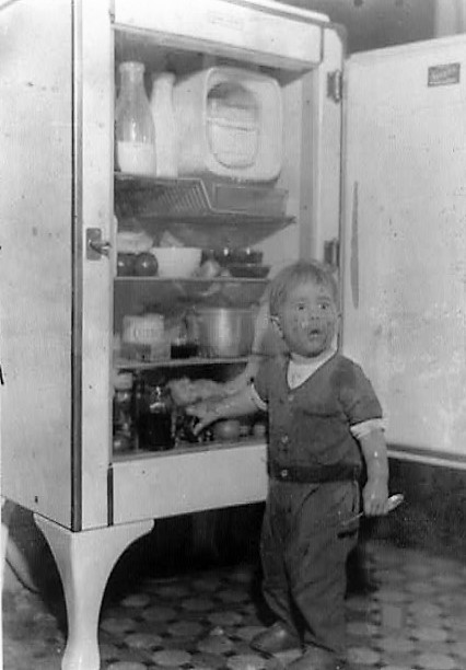 Door - little boy at refrigerator door Surprise (Library of Congress)