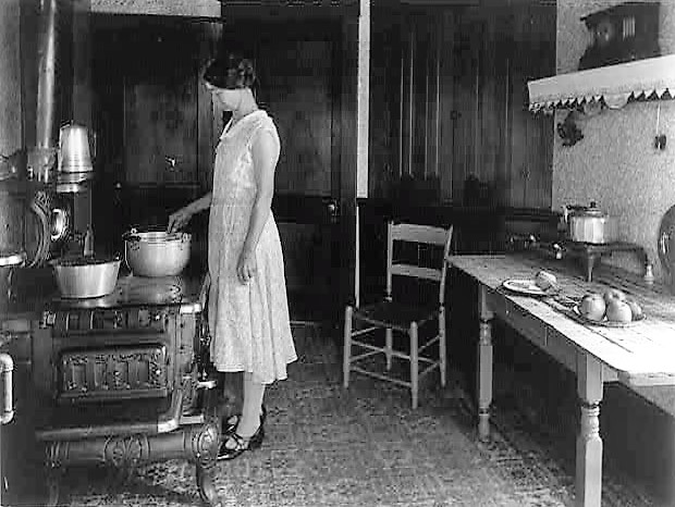 farm-woman-cooking-at-stove-in-kitchen-ca-1925-library-of-congress-2