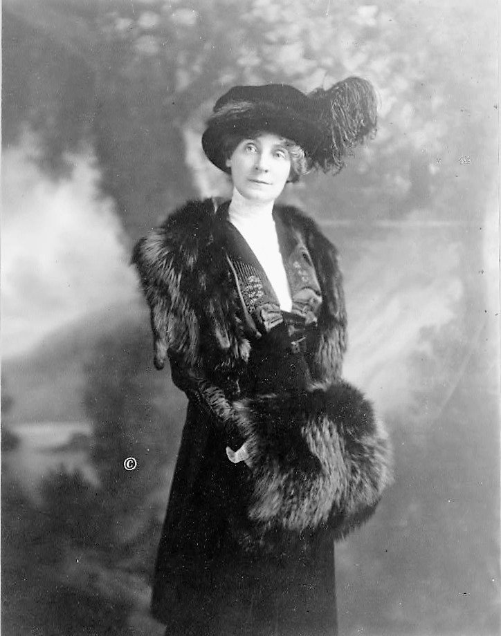 Florence H. Marshall, three-quarter length portrait, standing, facing front holding fur muff ca. 1914 (Library of Congress)