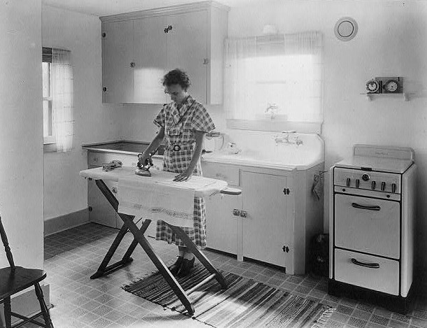 Ironing - Woman ironing in the kitchen ca. 1925 (Library of Congress) (2)