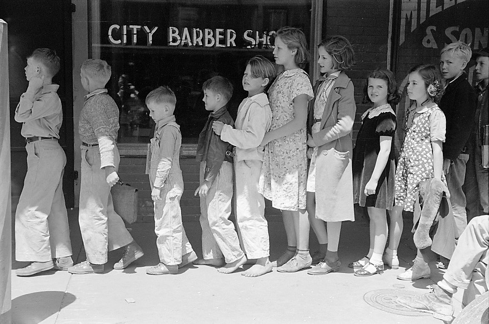 Schoolchildren waiting in line to go to the movies, San Augustine, Texas, April 1939 (Russell Lee, Library of Congress) (2)