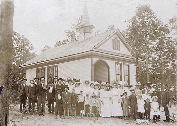children-and-adults-standing-outside-the-school-building-in-district-34-of-cleburne-county-ca-1900-alabama-department-of-archives-and-history