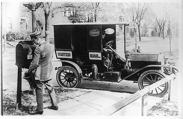 mail-carrier-empyting-mail-box-ca-1915-library-of-congress