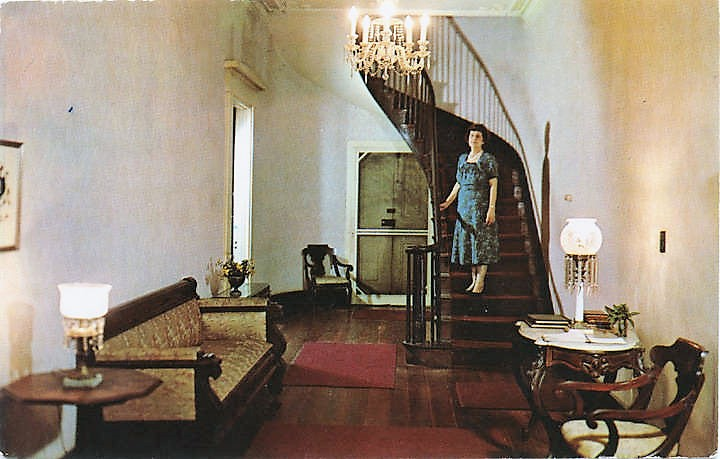 this-view-shows-the-hallway-and-stairs-with-the-hobson-family-crest-on-the-left-wall-miss-margaret-hobson-shrine-to-her-brother-richmond-hobson-ca-1950-postcard-adah
