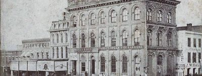 PATRON + A London, England Insurance company owned a massive building in Montgomery, Alabama before 1870.